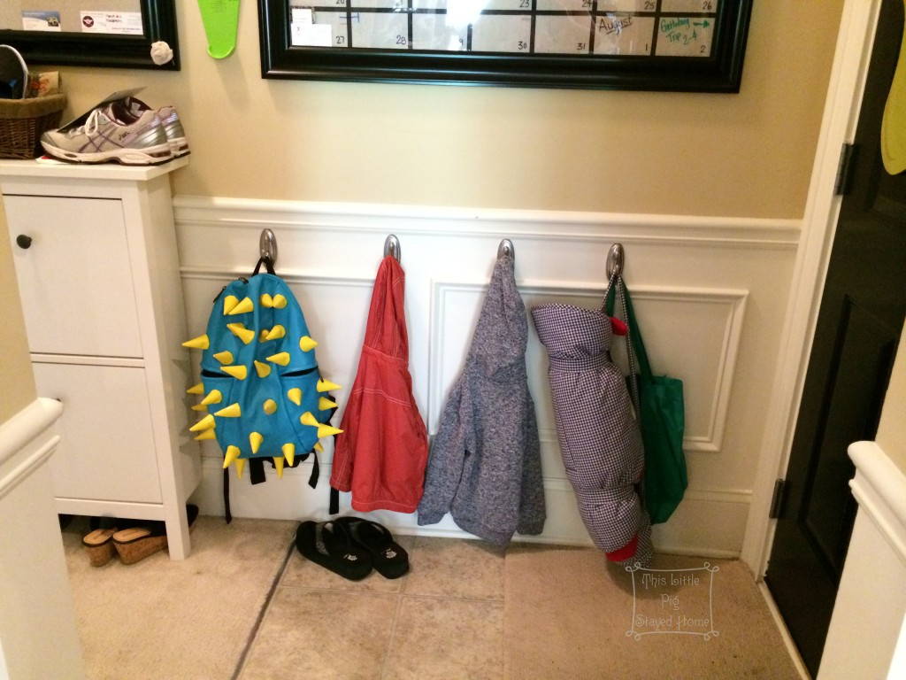 Hooks for hanging jackets, mats, or backpacks at the garage door