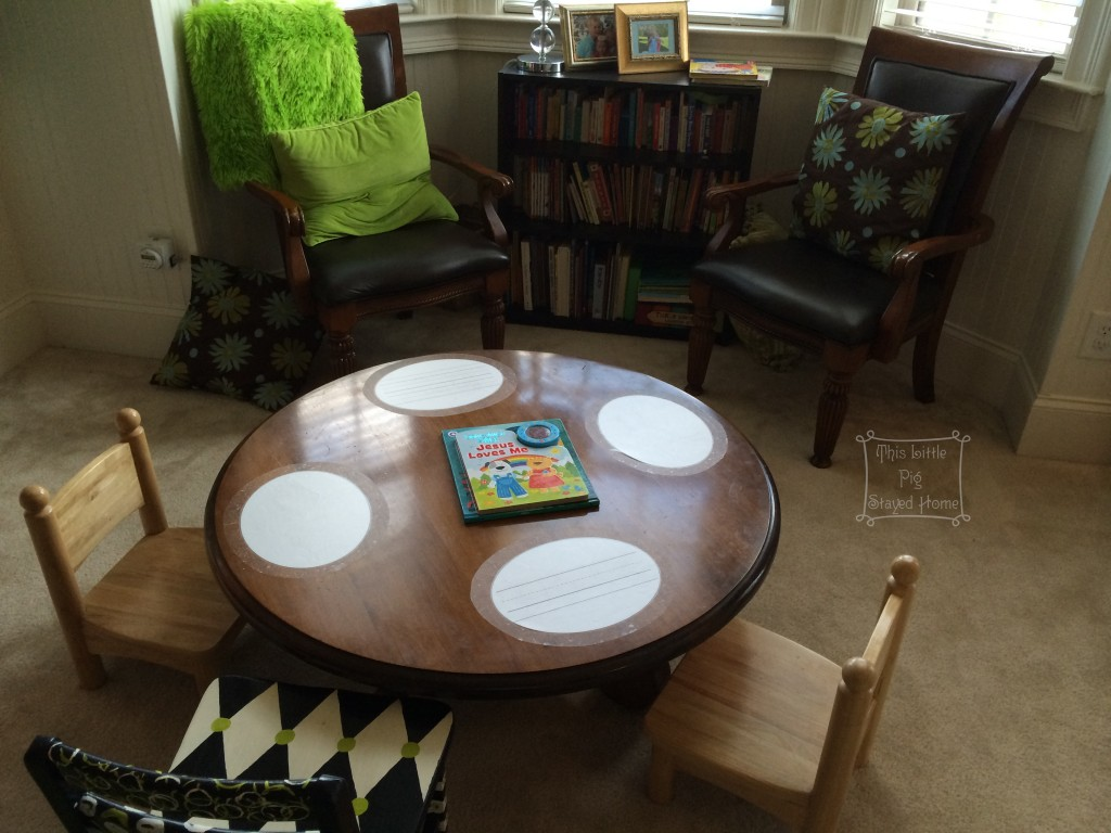 Home School Board Book Library, small work table, and adult reading chairs. Home School library