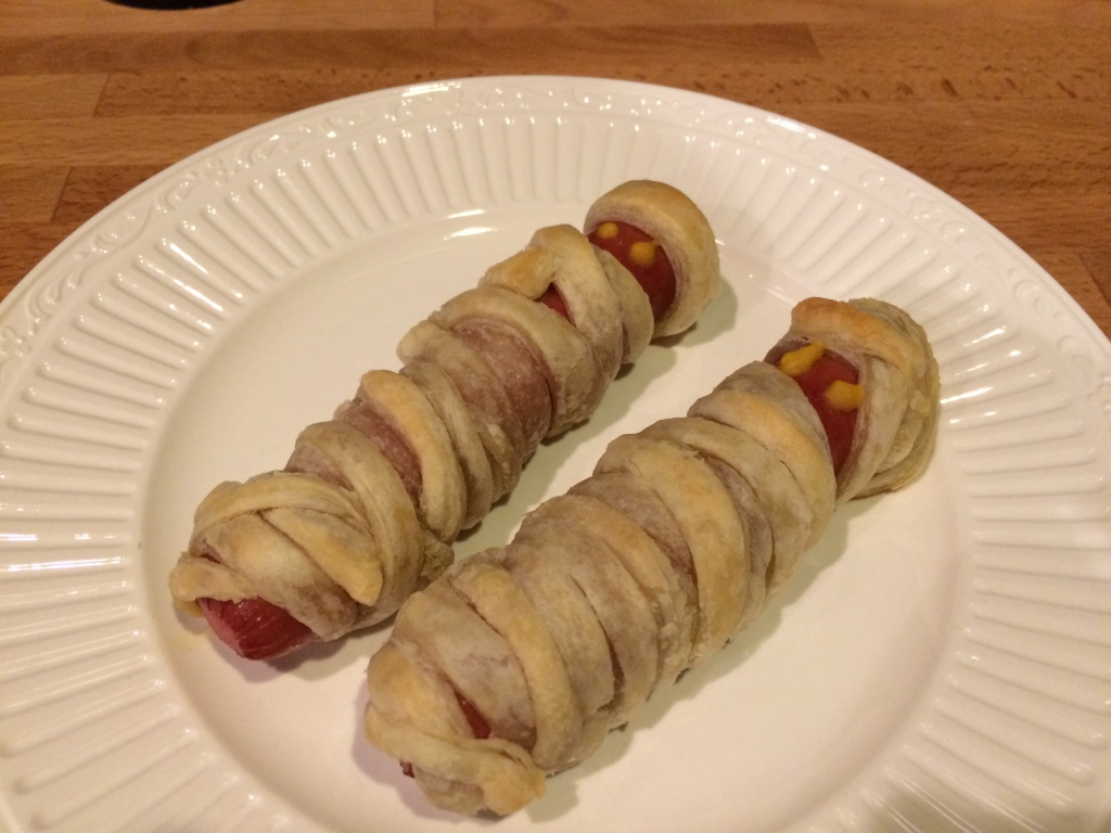 Mummy Dogs - Wrap thin strips of pastry dough, pie dough, or crescent roll dough around a hotdog and back in 350º oven for 20 min.